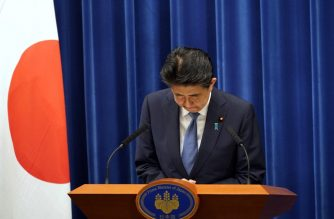 Japanese Prime Minister Shinzo Abe bows during his press conference at the prime minister official residence in Tokyo on August 28, 2020. - Japan's Prime Minister Shinzo Abe announced on August 28, 2020 he will resign over health problems, in a bombshell development that kicks off a leadership contest in the world's third-largest economy. (Photo by Franck ROBICHON / POOL / AFP)
