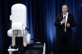 "This video grab made from the online Neuralink livestream shows Elon Musk standing next to the surgical robot during his Neuralink presentation on August 28, 2020. - Futurist entrepreneur Elon Musk late August 28 demonstrated progress made by his Neuralink startup in meshing brains with computers, saying the work is vital to the future of humanity. (Photo by - / Neuralink / AFP) / RESTRICTED TO EDITORIAL USE - MANDATORY CREDIT ""AFP PHOTO / NEURALINK "" - NO MARKETING - NO ADVERTISING CAMPAIGNS - DISTRIBUTED AS A SERVICE TO CLIENTS"