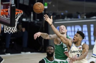 LAKE BUENA VISTA, FL - JULY 31: Giannis Antetokounmpo #34 of the Milwaukee Bucks, right, heads to the basket as Daniel Theis #27 of the Boston Celtics defends during the second half of an NBA basketball game Friday, July 31, 2020, in Lake Buena Vista, Florida. NOTE TO USER: User expressly acknowledges and agrees that, by downloading and or using this photograph, User is consenting to the terms and conditions of the Getty Images License Agreement.   Ashley Landis-Pool/Getty Images/AFP