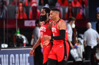 Orlando, FL - AUGUST 2: James Harden #13 of the Houston Rockets and Russell Westbrook #0 of the Houston Rockets talk during a game against the Milwaukee Bucks on August 2, 2020 at The Arena at ESPN Wide World Of Sports Complex in Orlando, Florida. NOTE TO USER: User expressly acknowledges and agrees that, by downloading and/or using this Photograph, user is consenting to the terms and conditions of the Getty Images License Agreement. Mandatory Copyright Notice: Copyright 2020 NBAE   Jesse D. Garrabrant/NBAE via Getty Images/AFP