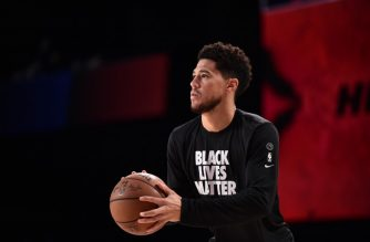 Orlando, FL - AUGUST 8: Devin Booker #1 of the Phoenix Suns warms up prior to the game against the Miami Heat on August 8, 2020 at Visa Athletic Center at ESPN Wide World of Sports in Orlando, Florida. NOTE TO USER: User expressly acknowledges and agrees that, by downloading and/or using this Photograph, user is consenting to the terms and conditions of the Getty Images License Agreement. Mandatory Copyright Notice: Copyright 2020 NBAE   David Dow/NBAE via Getty Images/AFP