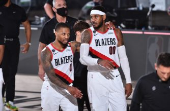 Orlando, FL - AUGUST 9: Damian Lillard #0 of the Portland Trail Blazers and Carmelo Anthony #00 of the Portland Trail Blazers talk after a game against the Philadelphia 76ers on August 9, 2020 at Visa Athletic Center at ESPN Wide World of Sports in Orlando, Florida. NOTE TO USER: User expressly acknowledges and agrees that, by downloading and/or using this Photograph, user is consenting to the terms and conditions of the Getty Images License Agreement. Mandatory Copyright Notice: Copyright 2020 NBAE   Jesse D. Garrabrant/NBAE via Getty Images/AFP