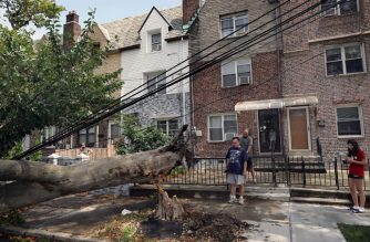 NEW YORK, NEW YORK - AUGUST 04: Downed trees block a road in a Brooklyn neighborhood as Tropical Storm Isaias churns its way up the East Coast on August 04, 2020 in New York City.The storm, which regained hurricane strength Monday night, has brought heavy rainfall, lightning, strong winds and flooding to the New York City area on Tuesday afternoon.   Spencer Platt/Getty Images/AFP
