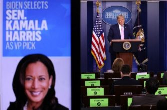WASHINGTON, DC - AUGUST 11: U.S. President Donald Trump speaks as a picture of Sen. Kamala Harris (D-CA) is seen on a screen during a news conference in the James Brady Press Briefing Room of the White House August 11, 2020 in Washington, DC. Trump discussed the coronavirus and several other topics, including the announcement by Democratic presidential candidate, former Vice President Joe Biden that he has chosen Sen. Kamala Harris to be his running mate in the 2020 general election.   Alex Wong/Getty Images/AFP
