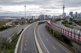 The normally busy central motorway interchange is deserted mid-morning in Auckland, New Zealand on August 14, 2020.   Auckland on August 14, 2020. - New Zealand rushed to track the source of a sudden return of the coronavirus as the number of new cases in its biggest city rose to 17 and officials warned more infections were inevitable. (Photo by DAVID ROWLAND / AFP)