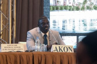 """Senegalese-American singer and songwriter Akon speaks to the press in a hotel in Dakar, on August 31, 2020, to present plans to create a city named """"Akon City"""". - The rapper, whose real name is Alioune Badara Thiam, pledged to invest in tourism in his native Senegal where he spent his early childhood before moving to the US at age seven, where he later rose to superstardom. (Photo by Seyllou / AFP)"""
