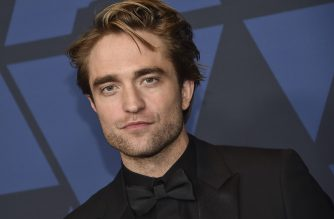 "(FILES) In this file photo taken on October 27, 2019 British actor Robert Pattinson arrives to attend the 11th Annual Governors Awards gala hosted by the Academy of Motion Picture Arts and Sciences at the Dolby Theater in Hollywood. - Filming for the latest Batman-centered film, starring Robert Pattinson, has been halted in Britain after the actor reportedly tested positive for the coronavirus, just days after shooting had resumed. ""A member of 'The Batman' production has tested positive for Covid-19, and is isolating in accordance with established protocols,"" Warner Bros. said in a statement to AFP. ""Filming is temporarily paused."" (Photo by Chris Delmas / AFP)"