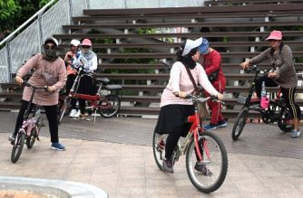 Residents go on a weekend bicycle ride in Jakarta on September 5, 2020, as the number of Covid-19 infections continue to set new daily record with the nationwide total approaching the 200,000 mark. (Photo by GOH CHAI HIN / AFP)