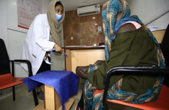 "A member of the medical staff examines patient Khadija Ahmad at the Mycetoma Reseach Center in the Sudanese city of Soba, 10Km south of the capital Khartoum, on September 7, 2020. - Dubbed ""silent death"" in Sudan, this parasitic tissue-eating disease is not particularly lethal, but it attacks the skin, bones, and muscles, leading to limb amputation and slowly turning a patient's life into a living hell. (Photo by ASHRAF SHAZLY / AFP)"