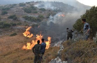 "A handout picture released by the official Syrian Arab News Agency (SANA) on September 8, 2020 shows security forces walking on a burnt hill Ain Halaqim, in the western countryside of Hama Governorate, during fires. (Photo by - / SANA / AFP) / == RESTRICTED TO EDITORIAL USE - MANDATORY CREDIT ""AFP PHOTO / HO / SANA"" - NO MARKETING NO ADVERTISING CAMPAIGNS - DISTRIBUTED AS A SERVICE TO CLIENTS =="