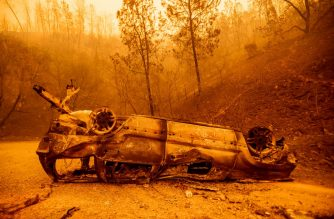FILES: The charred remains of a vehicle is left on the side of a road during the Bear fire, part of the North Lightning Complex fires, in unincorporated Butte County, California on September 09, 2020.  After a serious car accident, firefighters and police officers assisted an injured driver out of their vehicle as flames surrounded the area in the early hours of the day. - Dangerous dry winds whipped up California's record-breaking wildfires and ignited new blazes Tuesday, as hundreds were evacuated by helicopter and tens of thousands were plunged into darkness by power outages across the western United States. (Photo by JOSH EDELSON / AFP)