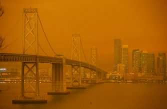 "FILES: The San Francisco Bay Bridge and city skyline are obscured in orange smoke and haze as their seen from Treasure Island in San Francisco, California on September 9, 2020. - More than 300,000 acres are burning across the northwestern state including 35 major wildfires, with at least five towns ""substantially destroyed"" and mass evacuations taking place. (Photo by Brittany Hosea-Small / AFP)"