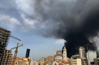 A picture shows smoke from a huge fire raging in Beirut port on September 10, 2020. - Thick black columns of smoke rose into the sky, as the army said it had engulfed a warehouse storing engine oil and vehicle tyres. (Photo by Joseph EID / AFP)