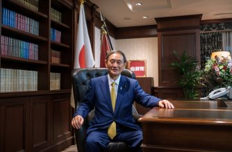 Newly elected leader of Japan's Liberal Democratic Party (LDP) Yoshihide Suga poses for a portrait at his office following a press conference at the party's headquarters in Tokyo on September 14, 2020. - Japan's ruling party on September 14 elected chief cabinet secretary Yoshihide Suga its new leader, making him all but certain to replace Shinzo Abe as the country's next prime minister. (Photo by Nicolas Datiche / POOL / AFP)