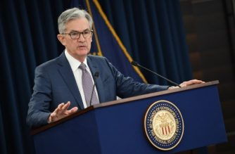 (FILES) In this file photo taken on March 03, 2020 US Federal reserve Chairman Jerome Powell gives a press briefing after the surprise announcement the FED will cut interest rates in Washington,DC. - Armed with a new interest rate strategy, the Federal Reserve will seek to reassure the US economy rattled by the coronavirus downturn as it wraps up its policy meeting on September 16, 2020. The central bankers opened the final day of their two-day policy meeting to news that retail sales slowed in August, adding to the argument that the world's largest economy needs more support, which Fed chair Jerome Powell has been encouraging in increasingly urgent statements. (Photo by Eric BARADAT / AFP)