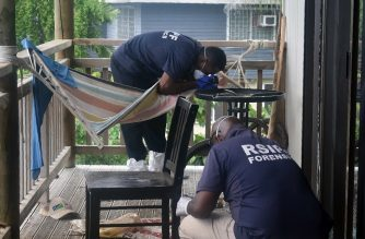 "This handout photograph released by the Royal Solomon Islands Police Force on September 21, 2020 shows forensics officers inspecting the site where two bomb disposal experts from Britain and Australia were killed when World War II-era ordnance they were helping to clear exploded. - Police said the blast took place on September 20 in the Pacific island nation's capital Honiara and the two foreign nationals died after being taken to hospital. (Photo by Handout / RSIPF / AFP) / RESTRICTED TO EDITORIAL USE - MANDATORY CREDIT ""AFP PHOTO / ROYAL SOLOMON ISLANDS POLICE FORCE "" - NO MARKETING - NO ADVERTISING CAMPAIGNS - DISTRIBUTED AS A SERVICE TO CLIENTS"