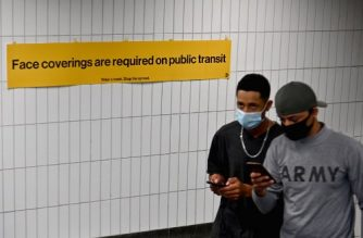(FILES) In this file photo people wearing face masks exit the subway station on August 31, 2020 in New York City. - The United States edged close to registering 200,000 Covid-19 deaths on September 21, 2020, the latest grim milestone for the country just weeks before voters decide if President Donald Trump stays in office. According to a rolling tally by Johns Hopkins University, 199,531 Americans have died and 6.8 million have been confirmed infected.The US has had the world's highest official death toll for months, ahead of Brazil and India, with 136,895 and 87,882 deaths respectively. (Photo by Angela Weiss / AFP)