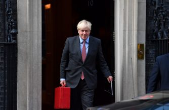 Britain's Prime Minister Boris Johnson reacts as he leaves 10 Downing Street in central London on September 21, 2020. - The UK government on Monday upgraded its coronavirus alert level, as its senior scientific advisor warned that England was on track for about 50,000 coronavirus cases a day by mid-October and a surging death toll unless action is taken immediately. (Photo by Ben STANSALL / AFP)