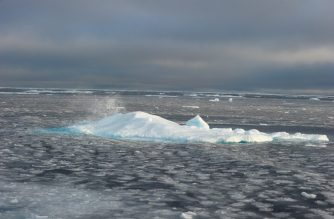 (FILES) In this September 23, 2015 file photo, ice chunks are seen in the Northwest Passage near the CCGS Amundsen, a Canadian research ice-breaker navigating in the Canadian High Arctic. - Arctic summer sea ice melted in 2020 to the second smallest area since records began 42 years ago, US scientists announced on September 21, 2020, offering further stark evidence of the impact of global warming. Artic sea ice melts in summer and reforms in winter, but precise satellite imagery taken regularly since 1979 had documented how the cycle has been shrinking significantly.The year's minimum was reached on September 15, at 3.74 million square kilometers (1.44 million square miles), according to scientists at the National Snow and Ice Data Center (NSIDC) at the University of Colorado Boulder. (Photo by Clement Sabourin / AFP)