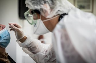 A medical assistant takes a sample from a patient for a coronavirus (Covid-19) test at an analysis laboratory in Le Peage-de-Roussillon, some 30kms south of Lyon, south-eastern France on September 22, 2020. (Photo by JEFF PACHOUD / AFP)