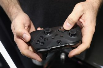 LOS ANGELES, CALIFORNIA - JUNE 11: Game enthusiasts test the Xbox 'Elite Wireless Controller Series 2' during the E3 Video Game Convention at the Microsoft Theater on June 11, 2019 in Los Angeles, California.   Christian Petersen/Getty Images/AFP
