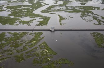 NEW ORLEANS, LA - AUGUST 23: The $1.1 billion Lake Borgne Surge Barrier stands near the confluence of and across the Gulf Intracoastal Waterway and the Mississippi River Gulf Outlet on August 23, 2019 in New Orleans, Louisiana. The massive structure was built by the Army Corps of Engineers along with other reinforcements to defend the city of New Orleans against future hurricanes and storms. The nearly 2 mile long, 26 foot high barrier is designed to block deadly storm surge from Lake Borgne, similar to what ravaged the Lower Ninth Ward during Hurricane Katrina. According to researchers at the National Oceanic and Atmospheric Administration (NOAA), Louisiana's combination of rising waters and sinking land give it one of the highest rates of relative sea level rise on the planet. Since the 1930s, Louisiana has lost over 2,000 square miles of land and wetlands, an area roughly the size of Delaware. In the past 30 years, as subsidence continues and the effects of climate change increase, Louisiana has been losing its coastal landscape at the rate of almost a football fields worth of land every hour.   Drew Angerer/Getty Images/AFP