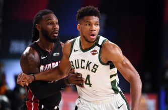 ORLANDO, FL - SEPTEMBER 6: Giannis Antetokounmpo #34 of the Milwaukee Bucks and Jae Crowder #99 of the Miami Heat fight for position during Game Four of the Eastern Conference Semifinals of the NBA Playoffs on September 6, 2020 at The AdventHealth Arena at ESPN Wide World Of Sports Complex in Orlando, Florida. NOTE TO USER: User expressly acknowledges and agrees that, by downloading and/or using this Photograph, user is consenting to the terms and conditions of the Getty Images License Agreement. Mandatory Copyright Notice: Copyright 2020 NBAE   Garrett Ellwood/NBAE via Getty Images/AFP