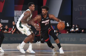 ORLANDO, FL - SEPTEMBER 8: Jimmy Butler #22 of the Miami Heat drives to the basket against the Milwaukee Bucks during Game Five of the Eastern Conference SemiFinals of the NBA Playoffs on September 8, 2020 at The Field House in Orlando, Florida. NOTE TO USER: User expressly acknowledges and agrees that, by downloading and/or using this Photograph, user is consenting to the terms and conditions of the Getty Images License Agreement. Mandatory Copyright Notice: Copyright 2020 NBAE   Nathaniel S. Butler/NBAE via Getty Images/AFP