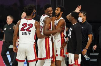 ORLANDO, FL - SEPTEMBER 15: Bam Adebayo #13 of the Miami Heat reacts with teammates after game winning block during Game One of the Eastern Conference Finals of the NBA Playoffs on September 15, 2020 at The Field House at ESPN Wide World Of Sports Complex in Orlando, Florida. NOTE TO USER: User expressly acknowledges and agrees that, by downloading and/or using this Photograph, user is consenting to the terms and conditions of the Getty Images License Agreement. Mandatory Copyright Notice: Copyright 2020 NBAE   Jesse D. Garrabrant/NBAE via Getty Images/AFP