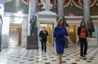 WASHINGTON, DC - SEPTEMBER 21: Speaker of the House Nancy Pelosi (D-CA), (C), wears a protective mask as she walks to the House Floor at the U.S. Capitol on September 21, 2020 in Washington, DC. Pelosi announced that Justice Ruth Bader Ginsburg, who passed away at the age of 87 due to complications from pancreatic cancer, will lie in state in Statuary Hall this Friday.   Stefani Reynolds/Getty Images/AFP