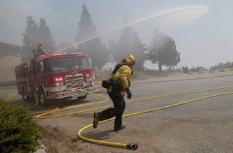PASADENA, CALIFORNIA - SEPTEMBER 16: Firefighters spray water at Mount Wilson Observatory in preparation for the arrival of a firefighting helicopter as the Bobcat Fire burns nearby in the Angeles National Forest on September 16, 2020 near Pasadena, California. The fire came within 500 feet of the historic 116-year-old observatory yesterday. California's national forests remain closed due to wildfires which have already incinerated a record 3.2 million acres this year. The Bobcat Fire, burning in the San Gabriel Mountains, has grown to over 44,000 acres.   Mario Tama/Getty Images/AFP
