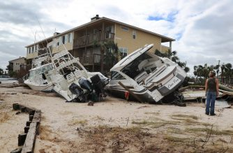 PENSACOLA, FL - SEPTEMBER 17: Boats are seen pushed up against a building at Lost Key Marina & Yacht Club after Hurricane Sally passed through the area on September 17, 2020 in Pensacola, Florida. The storm came ashore with heavy rain and high winds.   Joe Raedle/Getty Images/AFP