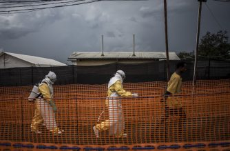 (File photo) Health workers escort a new unconfirmed Ebola patient, at a newly build MSF (Doctors Without Borders) supported Ebola treatment centre (ETC) on November 7, 2018 in Bunia, Democratic Republic of the Congo. - The death toll from an Ebola outbreak in eastern Democratic Republic of Congo has risen to more than 200, the health ministry said on November 10, 2018. (Photo by John WESSELS / AFP)