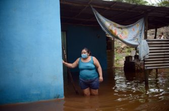 A woman from the Mayan community of Tecoh looks on during a flood caused by Tropical Storm Cristobal in the town of Tecoh, near Merida in Yucatan State, Mexico, on June 3, 2020. - Tropical Storm Cristobal's formation in the Gulf of Mexico marked a new record as the earliest that the Atlantic hurricane season has seen its third named disturbance, US meteorologists said Tuesday. (Photo by Luis PEREZ / AFP)