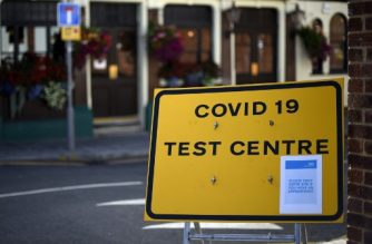 "A sign for a Covid-19 test centre is pictured in the street in Leyton in east London on September 17, 2020. - British Prime Minister Boris Johnson said Thursday he could close pubs earlier to ""stop the second hump"" of coronavirus cases, comparing the country's trajectory of resurgent transmission to a camel's profile. But the prime minister has faced stinging criticism this week over the failure to achieve the ""world-beating"" testing and tracing system he promised by the summer. (Photo by DANIEL LEAL-OLIVAS / AFP)"