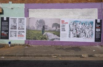 A general view of a poster mural setup by the international Committee of the Red Cross (ICRC) is seen at an initiative lead by the ICRC to make regular South Africans relate to common struggles around the world caused by the COVID-19 coronavirus, by setting up interactive posters in Jeppestown, in Johannesburg on September 23, 2020. (Photo by Emmanuel Croset / AFP)