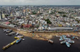 """Aerial view of Manaus, Amazonas state, Brazil, on September 25, 2020. - The Brazilian city of Manaus, which was devastated by the coronavirus pandemic, may have suffered so many infections that its population now benefits from """"herd immunity,"""" according to a preliminary study. Published on the website medRxiv, the study analyzed infection data with mathematical modeling to estimate that 66 percent of the population had antibodies to the new coronavirus in Manaus, where the pandemic's passage was as fast as it was brutal. (Photo by MICHAEL DANTAS / AFP)"""