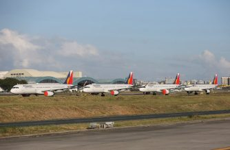 (FILES) This file photo taken on April 19, 2020 shows passenger planes from carrier Philippine Airlines parked on the tarmac of Manila's international airport as air travel to and from the Philippines was suspended after the government implemented a lockdown in its efforts to contain the spread of the COVID-19 coronavirus. - Philippine Airlines said late on October 5, 2020 that the flag carrier will cut a third of its workforce by yearend as it reels from the fallout of the coronavirus pandemic. (Photo by STR / AFP)