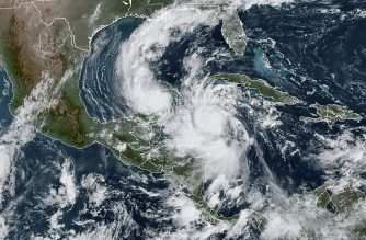 """This RAMMB/NOAA satellite image shows Hurricane Delta moving northwest in the Caribbean on October 6, 2020, at 15:20 UTC. - Hurricane Delta intensified rapidly into a Category 4 storm on October 6, 2020 and is set to slam into Mexico's Yucatan Peninsula early on October 7, 2020, the US National Hurricane Center said. Maximum sustained winds increased to 130 miles (215 kilometers) per hour, and the storm is """"forecast to be an extremely dangerous"""" hurricane when it makes landfall, the center said. (Photo by Handout / RAMMB/NOAA/NESDIS / AFP) / RESTRICTED TO EDITORIAL USE - MANDATORY CREDIT """"AFP PHOTO / RAMMB/NOAA"""" - NO MARKETING - NO ADVERTISING CAMPAIGNS - DISTRIBUTED AS A SERVICE TO CLIENTS"""