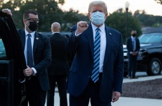 "(FILES) In this file photo taken on October 05, 2020 US President Donald Trump pumps his fist as he leaves Walter Reed Medical Center in Bethesda, Maryland heading towards Marine One, to return to the White House after being discharged. - President Donald Trump should be able to resume ""public engagements"" from October 10, 2020, the White House physician announced on October 8, saying the US leader has responded ""extremely well"" to Covid-19 treatment. (Photo by SAUL LOEB / AFP)"