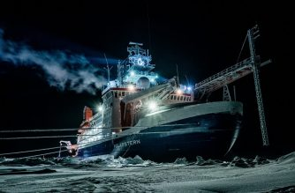 "(FILES) This file photo shows a handout picture released on May 27, 2020 by the Alfred-Wegener-Institute and taken on January 1, 2020 with the German research icebreaker ""Polarstern"" in the Central Arctic Ocean during polar night. - Researchers on the world's biggest polar mission saw first-hand how climate change is destroying the Arctic's ice sheets, the head of the mission told AFP as it prepared to dock in Germany on Monday, October 12, 2020. (Photo by Lukas PIOTROWSKI / Alfred Wegener Institut / AFP) / RESTRICTED TO EDITORIAL USE - MANDATORY CREDIT ""AFP PHOTO / Alfred-Wegener-Institut / Lukas Piotrowski - NO MARKETING NO ADVERTISING CAMPAIGNS - DISTRIBUTED AS A SERVICE TO CLIENTS"
