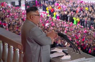 """A screen grab taken from a KCNA broadcast shows North Korean leader Kim Jong Un delivering a speech ahead of a military parade on Kim Il Sung square in Pyongyang on October 10, 2020. - Nuclear-armed North Korea held a giant military parade, television images showed, with thousands of maskless troops defying the coronavirus threat and Pyongyang expected to put on show its latest and most advanced weapons. (Photo by - / KCNA VIA KNS / AFP) / - South Korea OUT / REPUBLIC OF KOREA OUT   ---EDITORS NOTE--- RESTRICTED TO EDITORIAL USE - MANDATORY CREDIT """"AFP PHOTO/KCNA"""" - NO MARKETING NO ADVERTISING CAMPAIGNS - DISTRIBUTED AS A SERVICE TO CLIENTS THIS PICTURE WAS MADE AVAILABLE BY A THIRD PARTY. AFP CAN NOT INDEPENDENTLY VERIFY THE AUTHENTICITY, LOCATION, DATE AND CONTENT OF THIS IMAGE. /"""