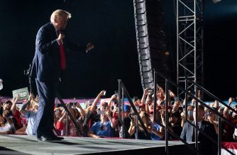 US President Donald Trump dances as he leaves a Make America Great Again rally as he campaigns at Orlando Sanford International Airport in Sanford, Florida, October 12, 2020. (Photo by SAUL LOEB / AFP)