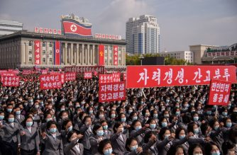In a photo taken on October 12, 2020 participants wearing face masks attend a rally marking the start of an '80-day Campaign' in support of the upcoming 8th Congress of the Workers' Party of Korea (WPK) to be held in January 2021, at Kim Il Sung Square in Pyongyang. (Photo by KIM Won Jin / AFP)
