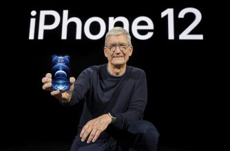 "In this photo released by Apple, Apple CEO Tim Cook holds up the all-new iPhone 12 Pro during an Apple event at Apple Park in Cupertino, California on October 13, 2020. (Photo by Brooks KRAFT / Apple Inc. / AFP) / RESTRICTED TO EDITORIAL USE - MANDATORY CREDIT ""AFP PHOTO/ Apple Inc./ Brooks Kraft"" - NO MARKETING - NO ADVERTISING CAMPAIGNS - DISTRIBUTED AS A SERVICE TO CLIENTS"