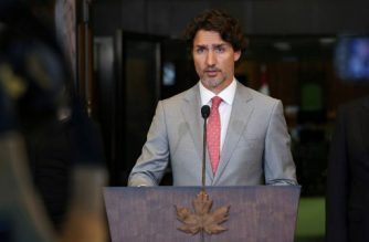 "(FILES) In this file photo taken on August 18, 2020 Canada's Prime Minister Justin Trudeau speaks during a news conference on Parliament Hill in Ottawa, Canada. - Canadian Prime Minister Justin Trudeau warned China on October 13, 2020, that its ""coercive diplomacy,"" repressive measures in Hong Kong and detention of Uighur Muslims are counterproductive for itself and the rest of the world. (Photo by Dave Chan / AFP)"