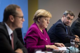 German Chancellor Angela Merkel (C), Bavaria's State Premier Markus Soeder (R) and Berlin's mayor Michael Mueller give a press conference after a meeting of states' leaders on the coronavirus situation in Berlin. on October 14, 2020. (Photo by STEFANIE LOOS / POOL / AFP)