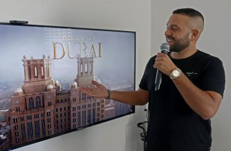 "Israeli singer Elkana Marziano, 28, sings along with a video clip of a song on which he worked in collaboration with Emirati artist Walid Aljasim (not in picture), during an interview with AFP at his home in the central Israeli city of Giv'at Shmuel, on October 15, 2020. - The normalisation of ties between Israel and the United Arab Emirates has produced its first musical collaboration: ""Ahlan Bik,"" or ""Hello you"" in Arabic, with lyrics that switch from Arabic to Hebrew to English to produce a slightly kitsch electro-pop duet by artists who, for now, remain apart. Aljasim and Marziano had collaborated over the Zoom video-conferencing service, with some parts of the song recorded in Dubai and others in Israel. (Photo by JACK GUEZ / AFP)"