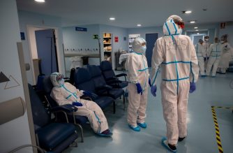 "Healthcare workers take a break at the Intensive Care Unit (ICU) of the Severo Ochoa University Hospital in Leganes on October 16, 2020. - At Severo Ochoa hospital in a Madrid suburb badly-hit during the pandemic's first wave, the intensive care unit is once again full and exhausted medics dread a repeat of the same ""horror"". (Photo by PIERRE-PHILIPPE MARCOU / AFP)"