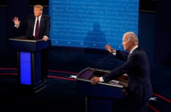 (FILES) In this file photo taken on September 29, 2020 US President Donald Trump and former Vice President and Democratic presidential nominee Joe Biden speak during the first presidential debate at the Health Education Campus of Case Western Reserve University in Cleveland, Ohio. - The US Commission on Presidential Debates announced on October 19, 2020 that they will mute the microphones of President Donald Trump and his Democratic rival Joe Biden when they are not answering questions during their final showdown, to avoid the interruptions that disrupted their last debate. (Photo by Morry GASH / POOL / AFP)